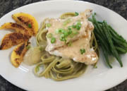 spinach fettuccine topped with boneless chicken breast
